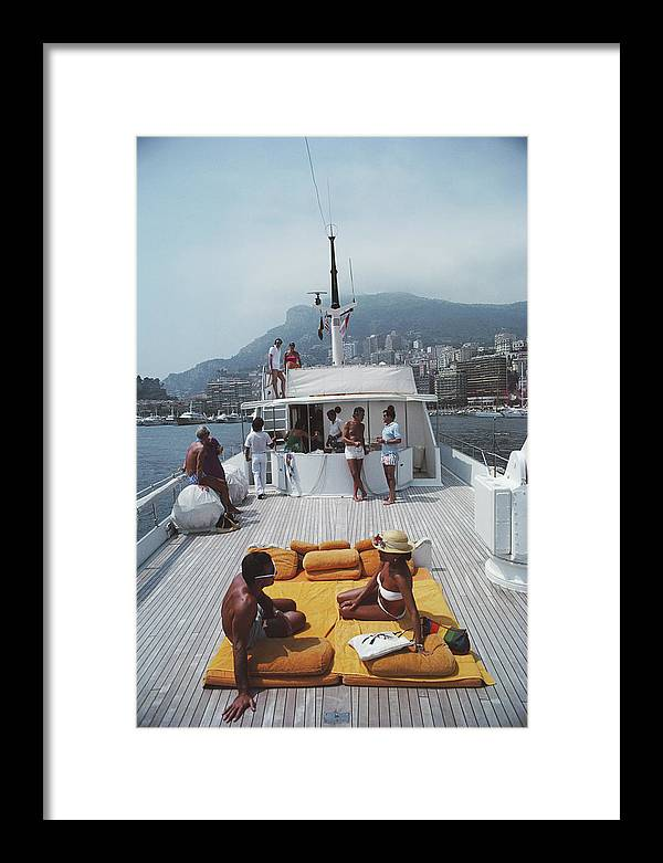 1980-1989 Framed Print featuring the photograph Scottis Yacht by Slim Aarons