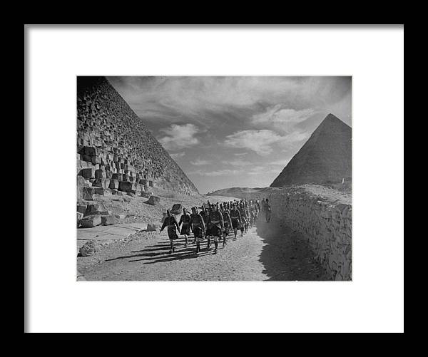 Marching Framed Print featuring the photograph Scottish Cameron Highlander And Indian T by Margaret Bourke-white