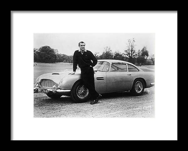 People Framed Print featuring the photograph Sean Connery With 007s Aston Martin by Bettmann