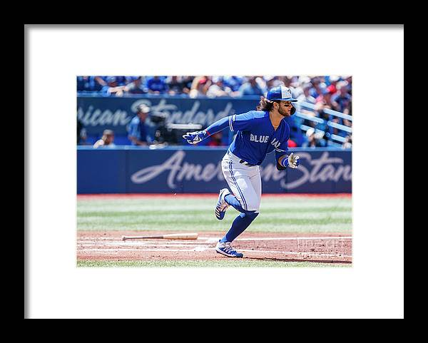 People Framed Print featuring the photograph Seattle Mariners V Toronto Blue Jays by Mark Blinch