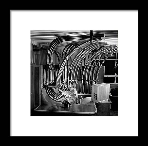 People Framed Print featuring the photograph Secretary With Pneumatic Tube by Walter Nurnberg