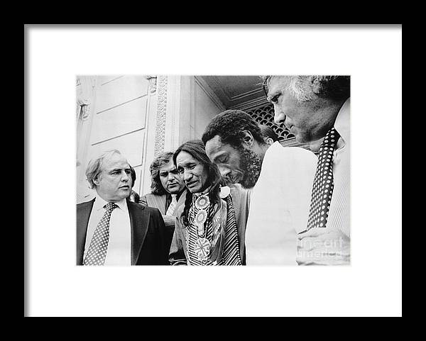 People Framed Print featuring the photograph Selo Blackcrow With Marlon Brando by Bettmann