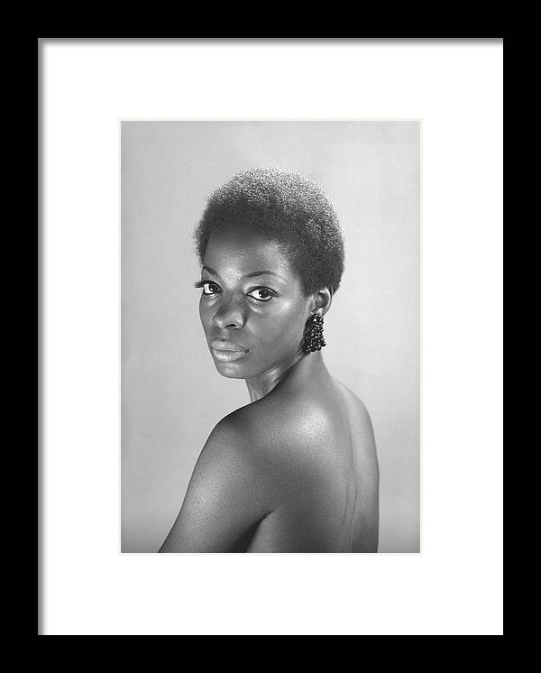 Looking Over Shoulder Framed Print featuring the photograph Semi Dress Woman Posing In Studio, B&w by George Marks