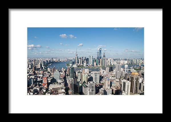 Tranquility Framed Print featuring the photograph Shanghai Skyline Across The Huangpu by Hugociss