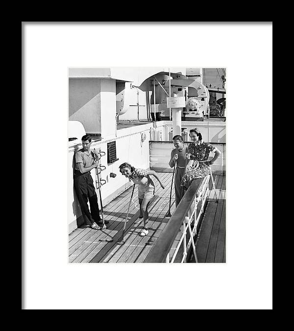 Heterosexual Couple Framed Print featuring the photograph Shuffleboard Players by George Marks