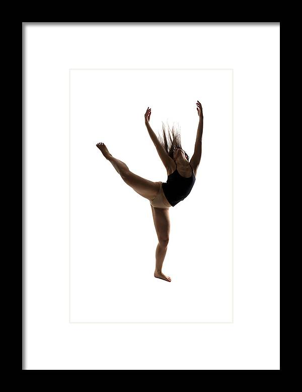 Ballet Dancer Framed Print featuring the photograph Silhouette Of A Performing Dancer by Opla