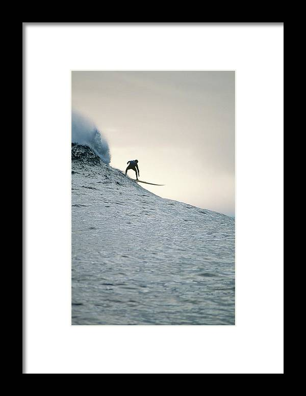 Scenics Framed Print featuring the photograph Silhouette Of A Surfer Riding A Wave by Dominic Barnardt