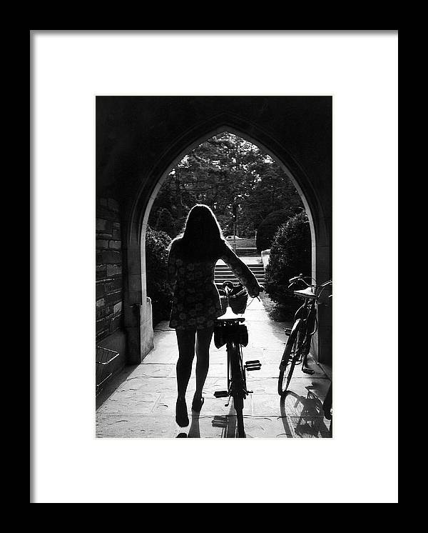 Arch Framed Print featuring the photograph Silhouette Of College Co-ed Walking Her by Alfred Eisenstaedt