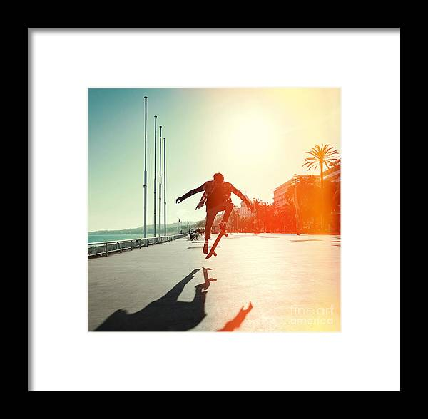 Heat Framed Print featuring the photograph Silhouette Of Skateboarder Jumping In by Maxim Blinkov