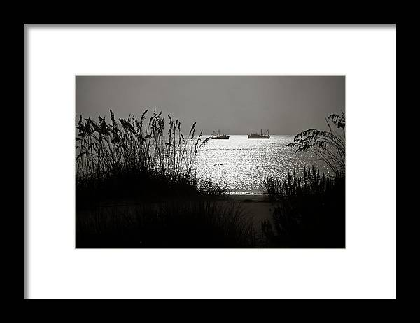 Tranquility Framed Print featuring the photograph Silhouettes Of Sea Oats And Shrimp Boats by Joseph Shields