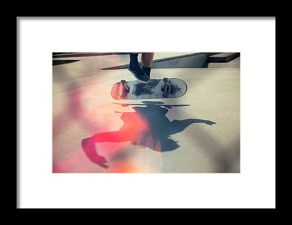 Cool Attitude Framed Print featuring the photograph Skateboarder Doing An Ollie by Devon Strong