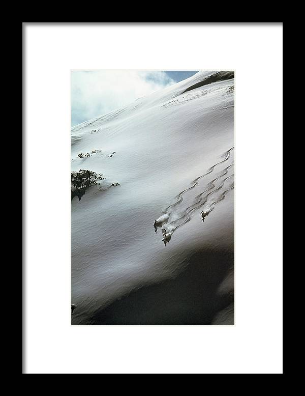 Shadow Framed Print featuring the photograph Skier Moving Down In Snow On Slope by John P Kelly