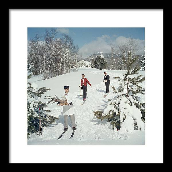 Skiing Framed Print featuring the photograph Skiing Waiters by Slim Aarons