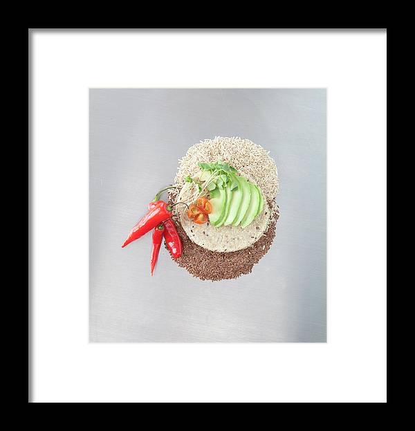 Flax Seed Framed Print featuring the photograph Sliced Avocado And Peppers With Grains by Laurie Castelli
