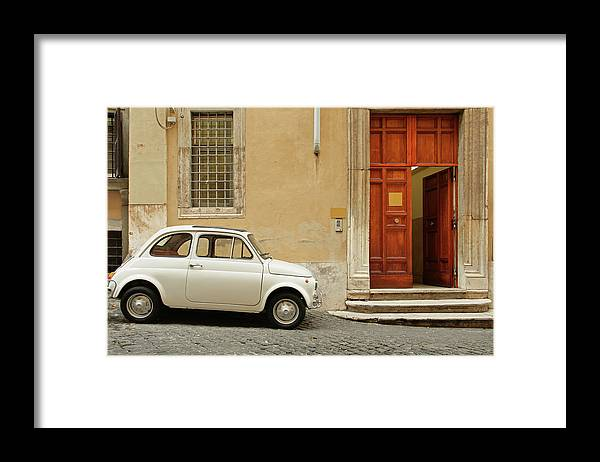 Steps Framed Print featuring the photograph Small Coupe Parked Near A Doorway On A by S. Greg Panosian