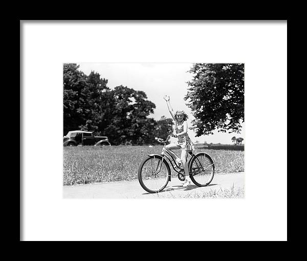 Bicycle Seat Framed Print featuring the photograph Smiling Girl Wearing A Jumper Short Set by H. Armstrong Roberts