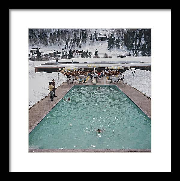 Child Framed Print featuring the photograph Snow Round The Pool by Slim Aarons