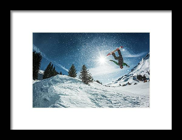 People Framed Print featuring the photograph Snowboarder Doing A Backflip With Snow by © Francois Marclay