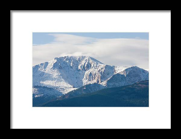 Extreme Terrain Framed Print featuring the photograph Snowy Pikes Peak by Swkrullimaging