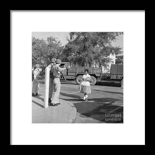 Young Men Framed Print featuring the photograph Soldiers Stopping African American Girl by Bettmann