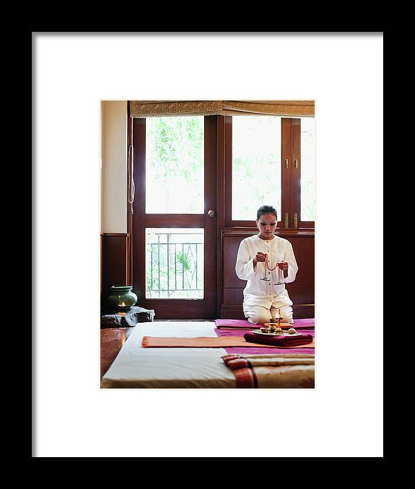 Spa Framed Print featuring the photograph Spa Therapist Prepares Massage Room by Matthew Wakem