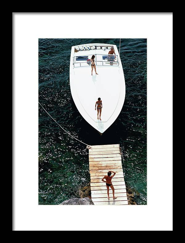 Motorboat Framed Print featuring the photograph Speedboat Landing by Slim Aarons