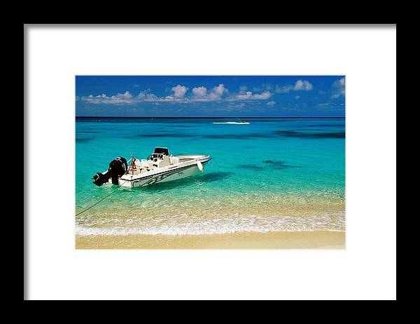 Tranquility Framed Print featuring the photograph Speedboat Moored At Conroy Beach by Richard Cummins