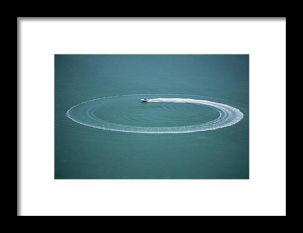 Recreational Pursuit Framed Print featuring the photograph Speedboat With Circular Wake by William R. Sallaz