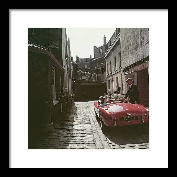People Framed Print featuring the photograph Sports Car Couple by Slim Aarons