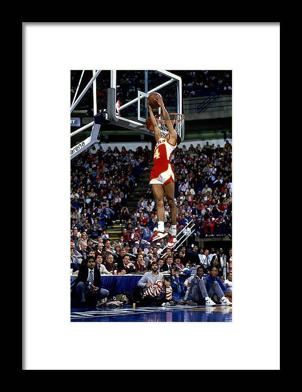 1980-1989 Framed Print featuring the photograph Spud Webb Reverse Dunk Slam Dunk by Andrew D. Bernstein