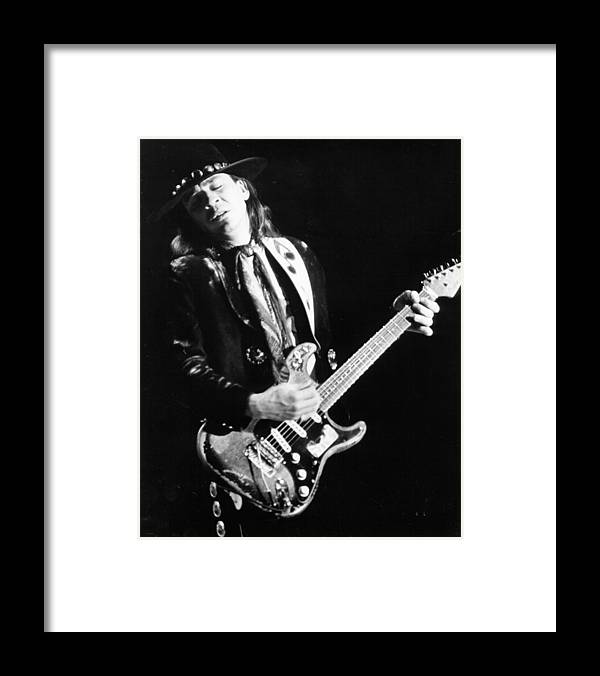 1980-1989 Framed Print featuring the photograph Srv Performing In Davis by Larry Hulst
