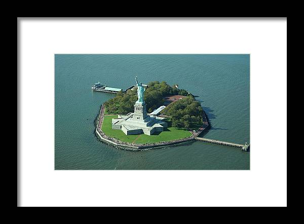 Shadow Framed Print featuring the photograph Statue Of Liberty by Copyright Www.floridaphoto.com 305.235.7051