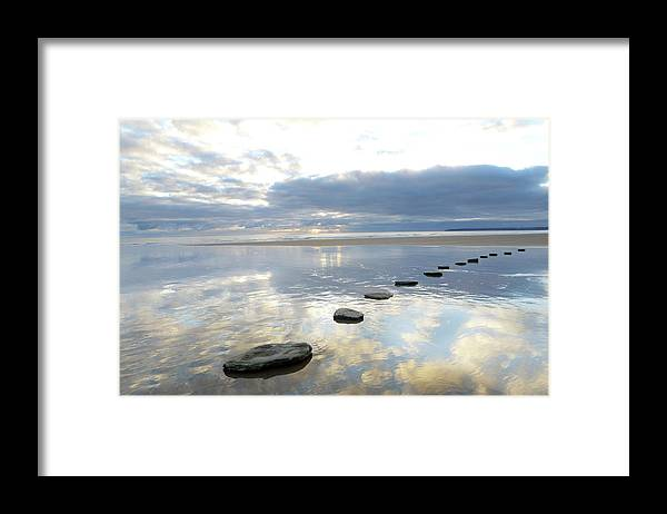 Tranquility Framed Print featuring the photograph Stepping Stones Over Water With Sky by Peter Cade