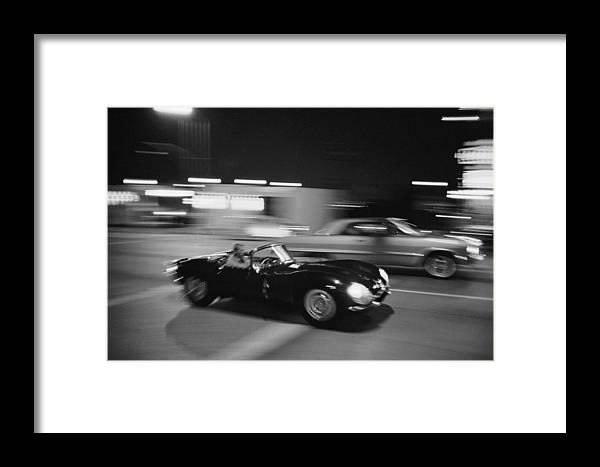 Steve Mcqueen Framed Print featuring the photograph Steve Mcqueen Driving Sunset Strip by John Dominis