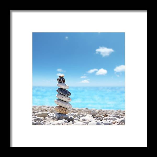 Water's Edge Framed Print featuring the photograph Stone Balance On Beach by Imagedepotpro