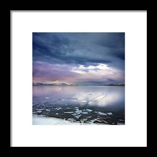 Scenics Framed Print featuring the photograph Storm Clouds Clearing Over Icy Lake by Utah-based Photographer Ryan Houston