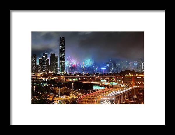 Firework Display Framed Print featuring the photograph Street Light Crosses Firework by Eddymtl
