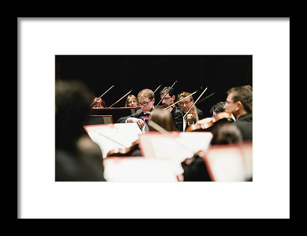 Young Men Framed Print featuring the photograph String Section In Orchestra by Hybrid Images