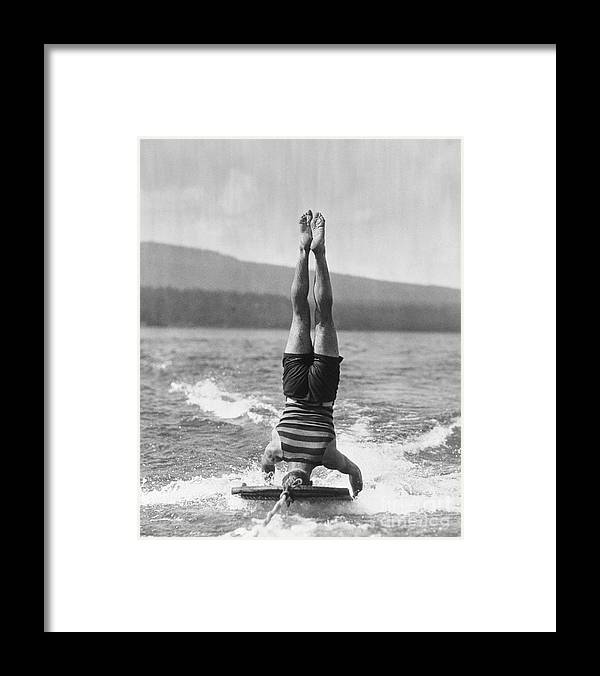 People Framed Print featuring the photograph Stunt Man Performing Aquaplane Feat by Bettmann
