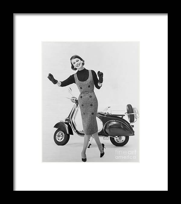People Framed Print featuring the photograph Stylish Woman And Scooter by Bettmann