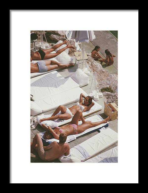 Recreational Pursuit Framed Print featuring the photograph Sunbathers At Eden Roc by Slim Aarons
