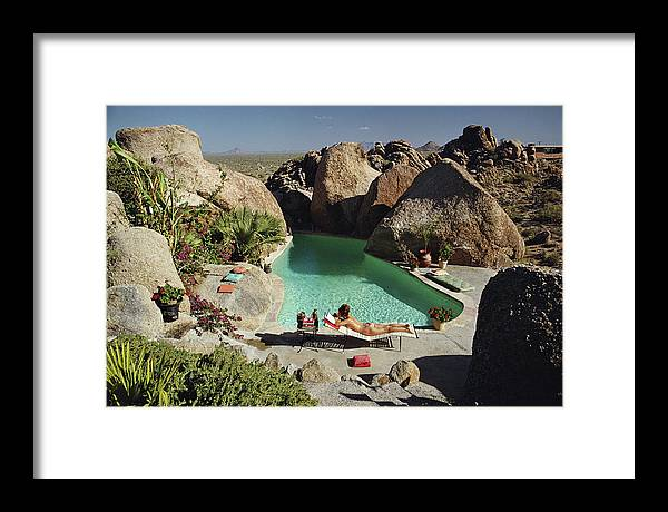 People Framed Print featuring the photograph Sunbathing In Arizona by Slim Aarons
