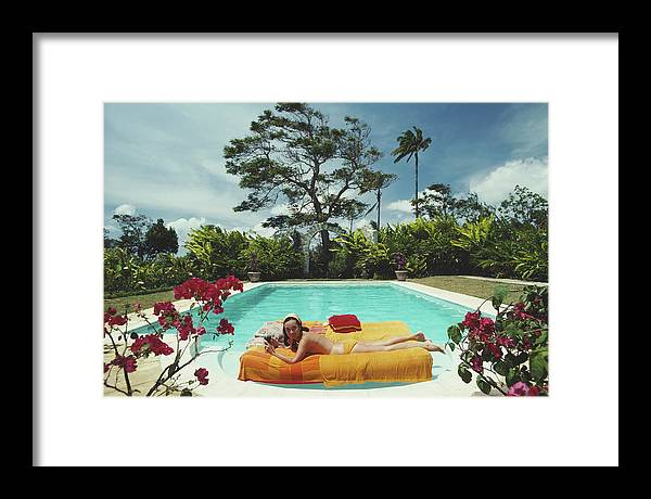 Artist Framed Print featuring the photograph Sunbathing In Barbados by Slim Aarons