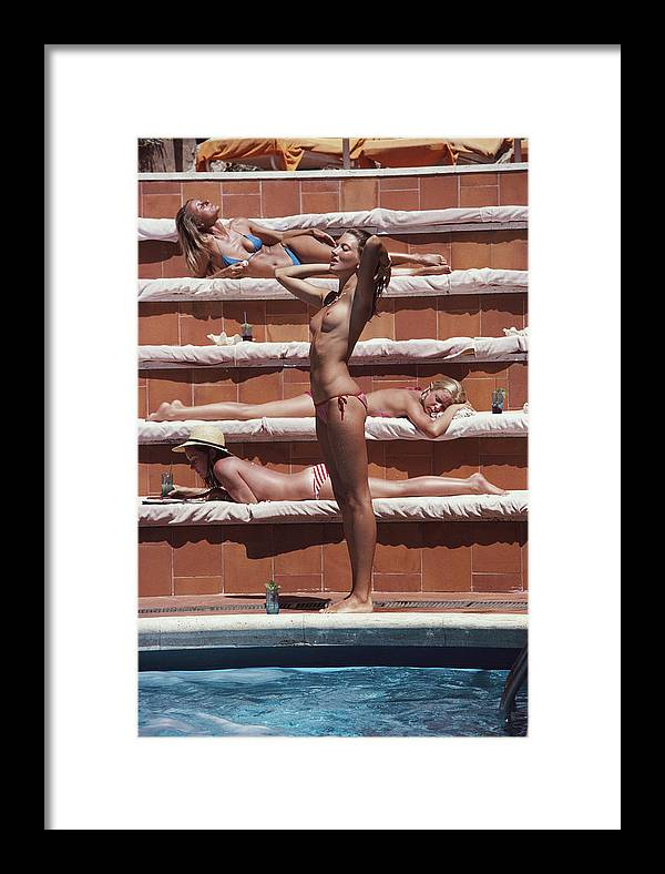 1980-1989 Framed Print featuring the photograph Sunbathing On Capri by Slim Aarons