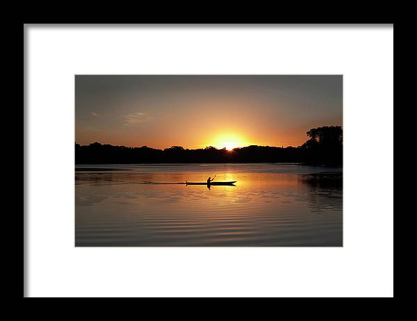 Water's Edge Framed Print featuring the photograph Sunset Kayaking In Lake Of The Isles by Yinyang