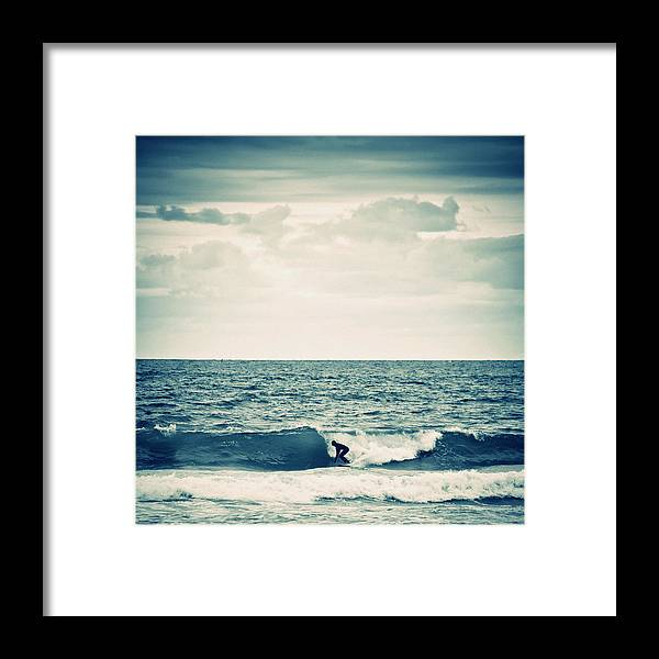 People Framed Print featuring the photograph Surfer In Action by Peeterv