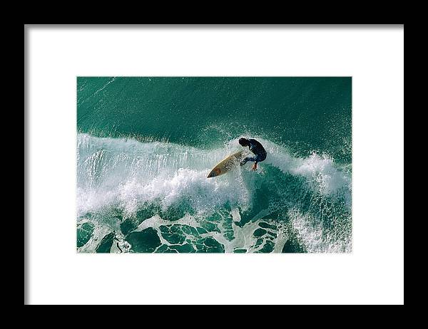 Tide Framed Print featuring the photograph Surfer Riding Wave by Stockbyte