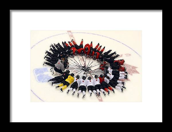 Rogers Arena Framed Print featuring the photograph Sweden V Finland by Bruce Bennett