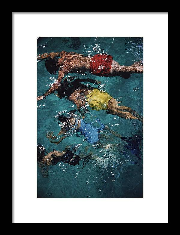 People Framed Print featuring the photograph Swimming In The Bahamas by Slim Aarons