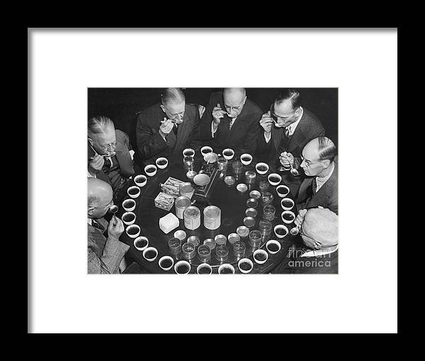Expertise Framed Print featuring the photograph Tea Experts Seated And Testing Teas by Bettmann